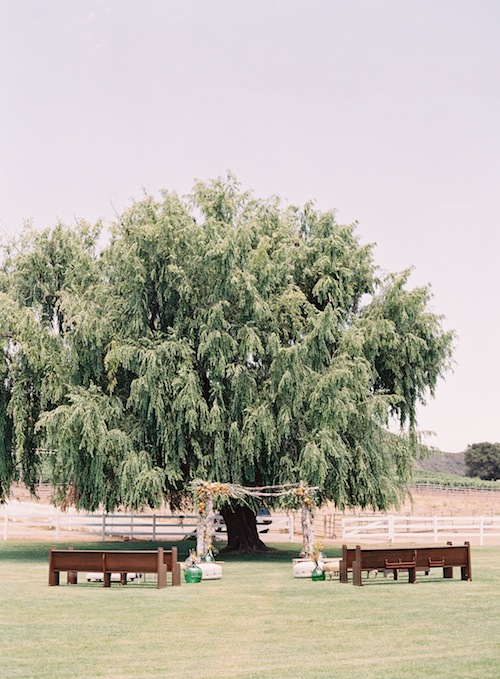 caroline-tran-propel-ceremony-malibu-wedding-outdoor-vintage-pews