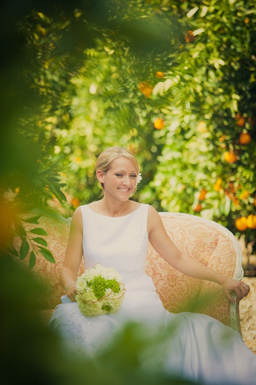 california-outdoor-wedding-orange-grove-bride-loveseat-peach-rustic