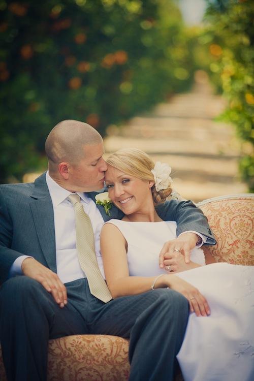 outdoor-rustic-orange-grove-wedding-california-peach-loveseat-couple